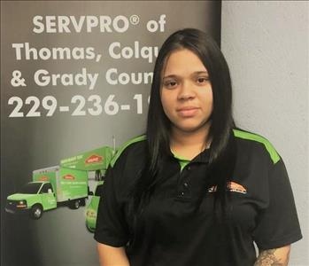 Young woman with long black hair in Servpro uniform